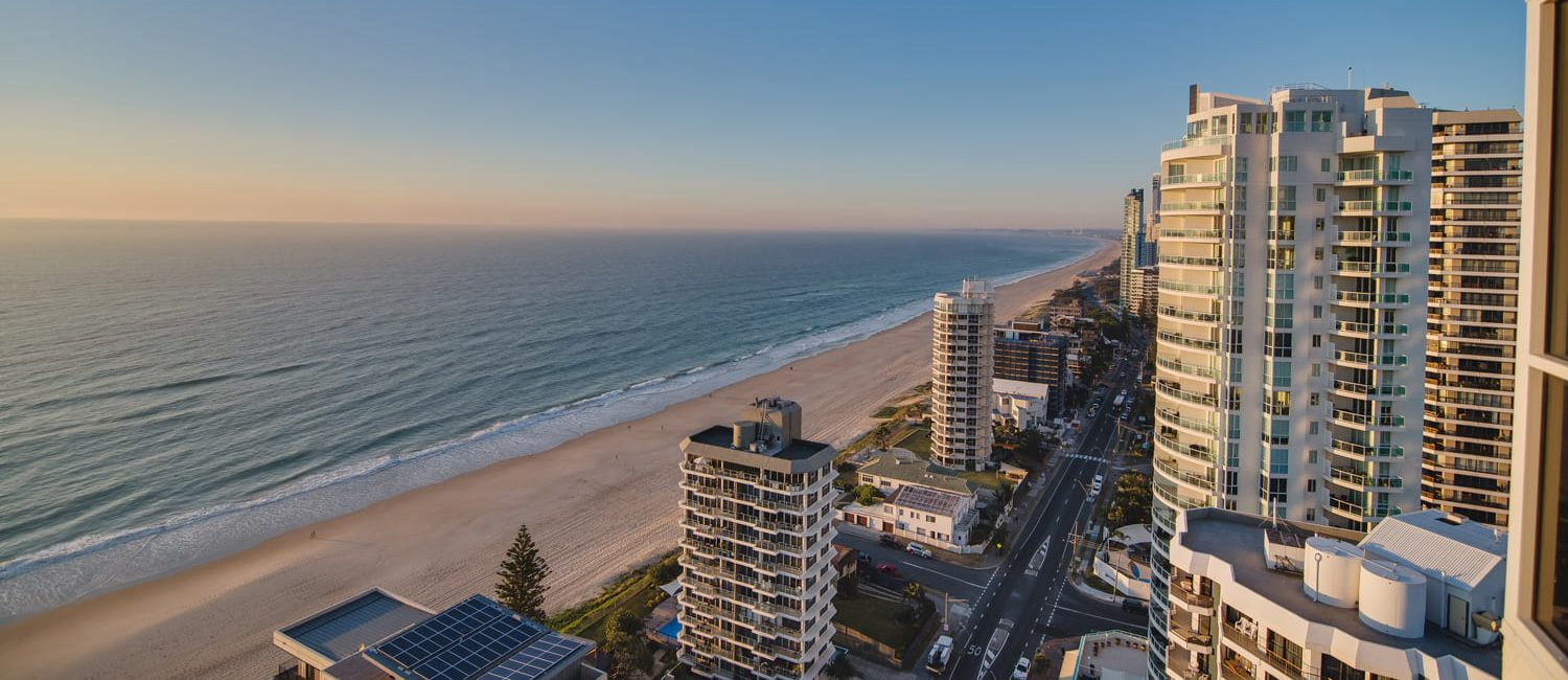 holiday accommodation gold coast main beach sunset ocean shoreline