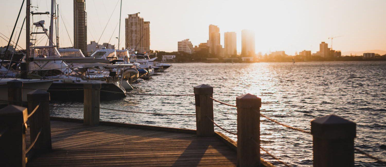 holiday accommodation gold coast wharf boats sunset